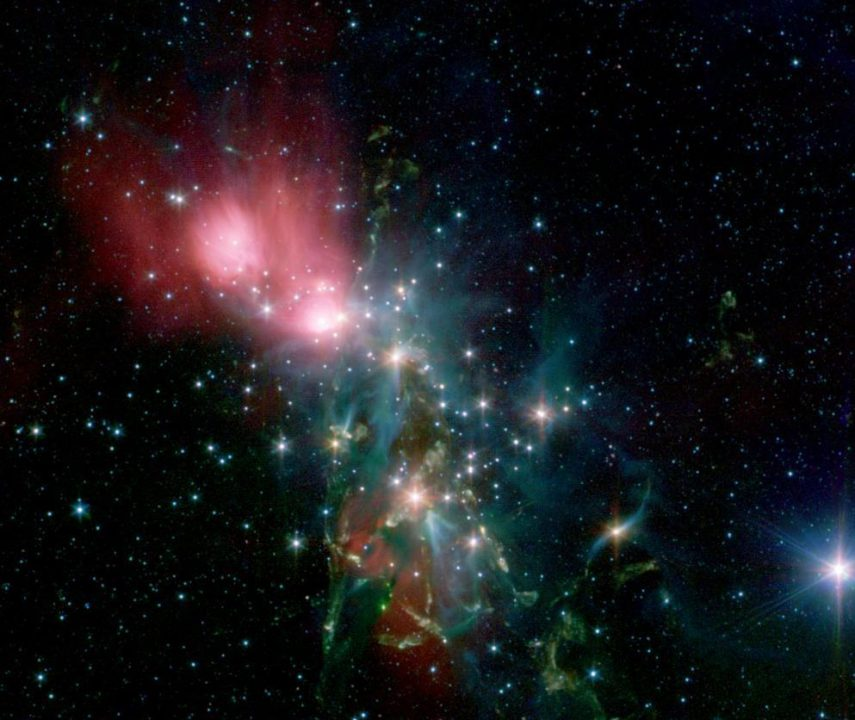 Located 1,000 light years from Earth in the constellation Perseus, a reflection nebula called NGC 1333 epitomizes the beautiful chaos of a dense group of stars being born. This image is from NASA Spitzer Space Telescope.